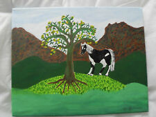 Horse under tree