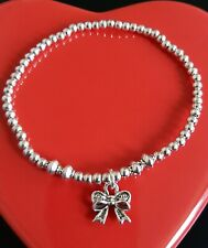 silver plated ball bead stretchy stacking bracelet with bow charm