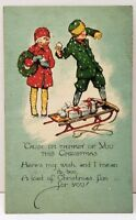 Christmas Children Throwing Snowballs Presents on sled 1927 Postcard E7