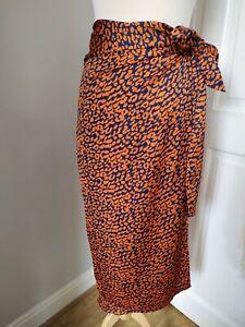 Never Fully Dressed S M Jaspre Cheetah Rust Orange Blue Animal Print Wrap Skirt