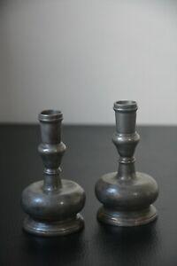 Pair Iberian bulbous pewter capstan continental candlestics