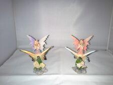 petites figurines fées sur papillons