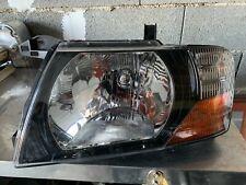 phare avant gauche pajero