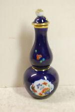 Small porcelain scent bottle, cobalt blue, bird, underglaze blue crossed swords
