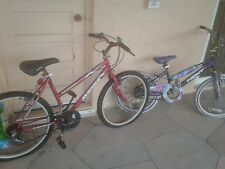 2 kids bicycles as they are,1 red,1 pink