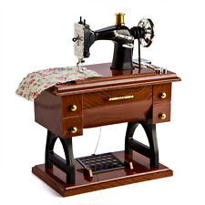 Mini sewing machine on desk that plays Beethoven's Fur Elise when drawer is open