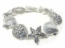 "Silvertone Seashell, starfish & sand dollar link bracelet,magnetic clasp, 7 1/2"""
