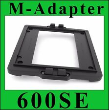 M Adapter for using  Mamiya Press Roll Film Holders to Polaroid 600SE Cameras.