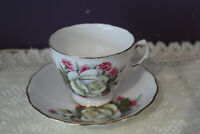 ROYAL VALE TEA CUP AND SAUCER WHITE ROSE WITH PINK CARNATION
