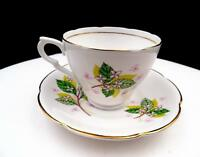 "LION BRAND ENGLAND FLORAL AND LEAVES 2 3/4"" CUP AND SAUCER SET"