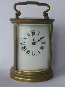 ANTIQUE ROUND FRENCH CARRIAGE CLOCK in good working order with key