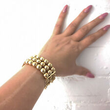 Beautiful 3 row gold tone bead & chain elasticated statement bracelet