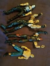 Lot of 4 WWE  Wrestling Figurines from 1999- 2011 Cane, Undertaker, Sting, Cena
