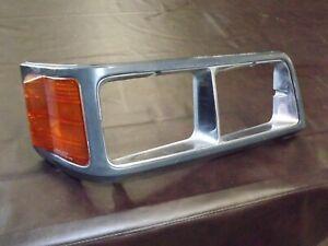 OEM 87-90 Mitsubishi Van Wagon headlight trim shroud corner light 046-1763 FR