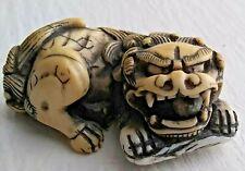 Japanese Netsuke Cow Bone Karashishi with Loose Ball in Mouth Edo Period 18th C.