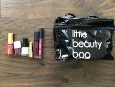 Bundle Of Lipsticks And Nail Polish And Makeup Bag