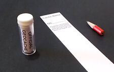 Clear Micro geocache with log and pencil for GPS geocaching.