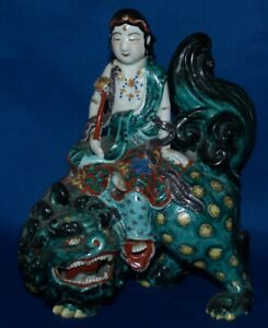 ANTIQUE JAPANESE KANNON RIDING ON A LION STATUE