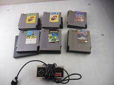 Lot jeux pour console Nintendo NES, Mario, Punch out, Paperboy, Turtles manette