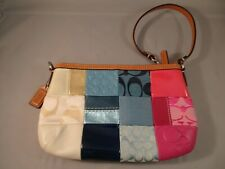 COACH patchwork wristlet with brown leather