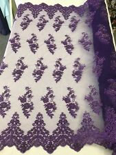 PURPLE HAND BEADED FLORAL DESIGN EMBROIDERY ON A MESH LACE-SOLD BY YARD.