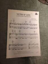Victim of love Eagles hotel california score partition guitare tablature chant
