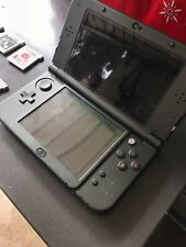 New 3D XL (Black) with Case and 8 Games