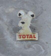 Pin's Total Idefix, fin des années 1980-début des années 1990