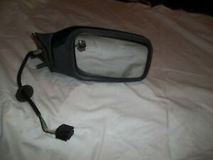 VOLVO 850 PASSENGER SIDE POWER MIRROR, USED.THE MIRROR IS GREEN. SEE PICTURES.