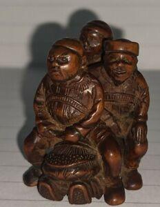 Meiji Netsuke fine carved Boxwood Netsuke depicting 3 men hiding a thief signed