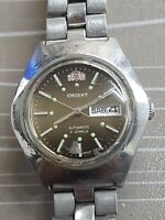 Vintage ladies Orient automatic 21 jewels day/date wrist watch.