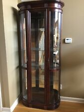 Pulaski Chocolate Cherry Curved Front Curio Cabinet