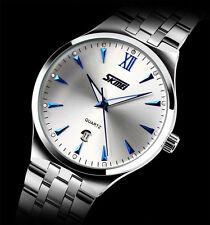SKMEI Reloj unisex analógico de cuarzo en acero plateado agujas azules con día
