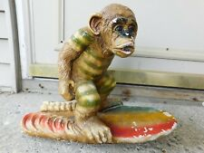 ANTIQUE LARGE CHALKWARE CHIMPANZEE ON SURFBOARD WEARING OLD TYPE SWIM SUIT