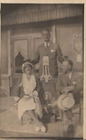 RPPC Postcard Advertising Spirit of Kentucky Whiskey ?  And Two Men + Woman