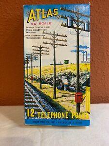 ATLAD HO SCALE. 12 Telephone Poles. #775