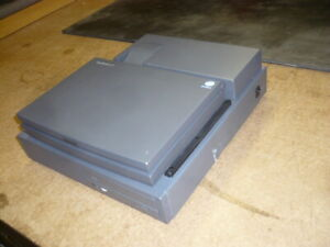 WinBook XP5 laptop with D3I charging expansion unit for desktop use