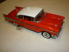 A Franklin mint scale model car of a 1957 Chevrolet Bel-air, hardtop