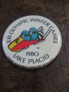 Vintage 1980 Lake Placid Olympics pin back raccoon luge bobsled