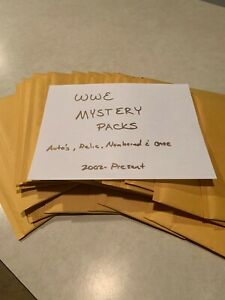 Topps WWE Card Mystery Pack. 35 cards with 1 Autograph or 1 Relic Per Pack!