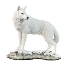 White Wolf Sculpture on Snowy Ground   WU75746AA