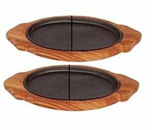 Rudra Exports Oval Shape Cast Iron Sizzler Plate and Wooden Stand (Set of 2)