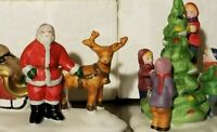 Vtg Lemax Dickensvale Christmas Figurines Set of 2 Santa with sled Trimming Tree
