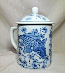 Chinese Koi fish with ginkgo leaves. Blue and white ceramic coffee lidded mug