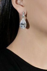 Surmount Set Drop-Dangle Earrings With A Pear Shaped & Brilliant Stones In Silve