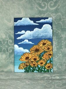 """Beautiful yellow flowers rise from the bottom on a canvas 5"""" x 7""""."""