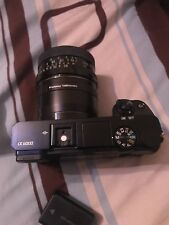 Sony Alpha a6000 Mirrorless w/ Tamron 28mm f/2.5 Lens, bag, pistol,& 16GB Bundle
