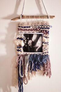 Pastel handwoven wall hanging photo frame.Boho weaving art interior decoration.