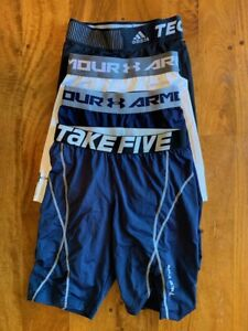 Four (4) pairs men's UNDER ARMOUR, ADIDAS, TAKE FIVE compression shorts | small