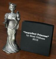 """CIRCA 2010 BRAD OLDHAM """"IMPERFECT PRINCESS"""" PEWTER FIGURINE WITH BAG AND BOOKLET"""